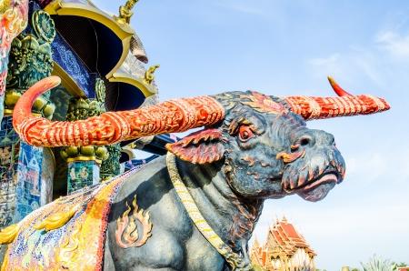 Thai style buffalo statue at Thai temple, Thailand photo