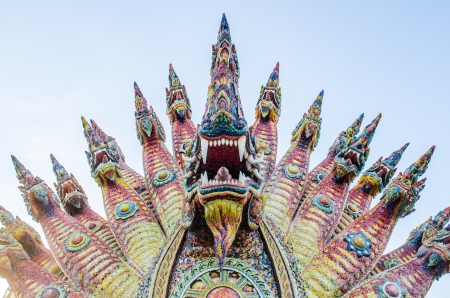 Naga statue with blue sky, Thailand photo