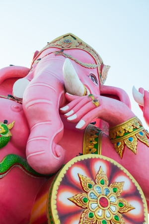 Pink Ganesha Statue on White Sky at Saman Rattanaram Temple, Chachoengsao Province, Thailand photo