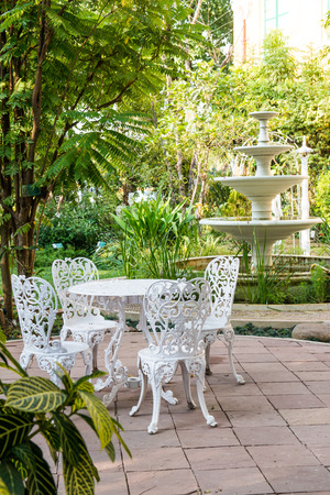 Dining table set in garden, Thailand