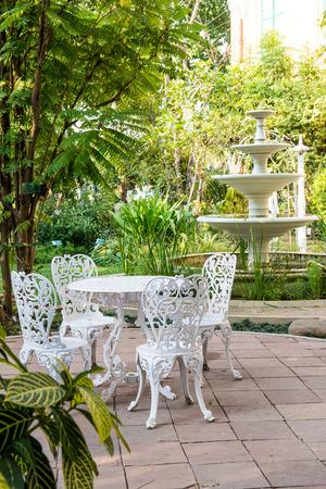 Dining table set in garden, Thailand