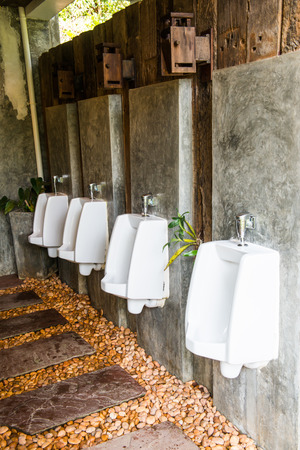 Row of Urinals in park, Thailand photo