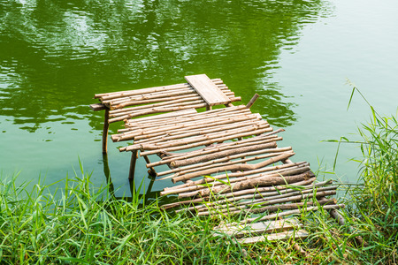 Lake and wood bridge in country, Thailand photo