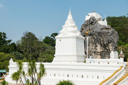 White pagoda and big stone at Phra Phutthabat temple, Thailand photo