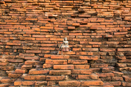 Ancient red brick wall with amulet, Thailand photo