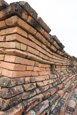 Ancient red brick wall at Thai temple, Thailand photo