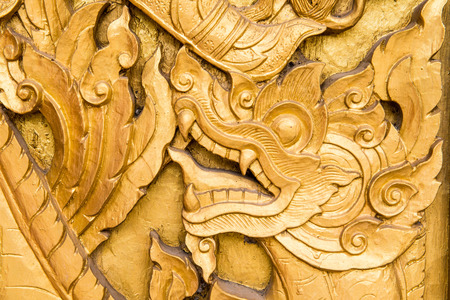 Wooden Thai style carving art at the temple, Thailand photo