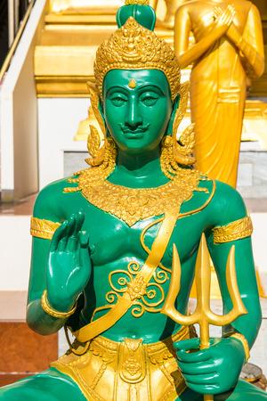 sacred trinity: Indra statue at Thai temple, Thailand Stock Photo