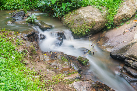 Beautiful water flowing at Maesa Noi waterfall, Thailand photo
