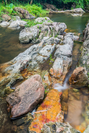 Rocks and water flowing in national park, Thailand photo