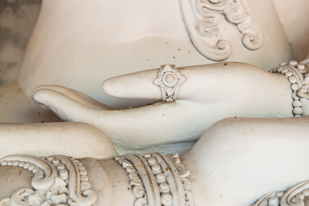 Hand of White Buddha Statue at Phrathat Hariphunchai Temple, Thailand