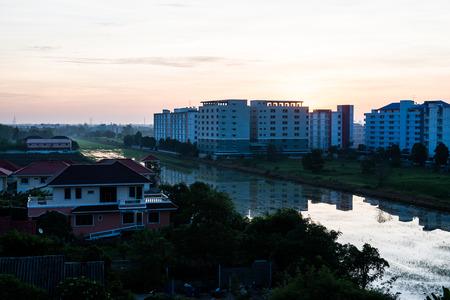 thani: Sun rising over Pathum Thani province, Thailand. Stock Photo