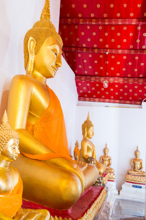 Ancient smiling buddha at Thai temple, Thailand. photo