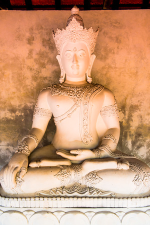 hariphunchai: White Buddha Statue at Phrathat Hariphunchai Temple, Thailand Stock Photo