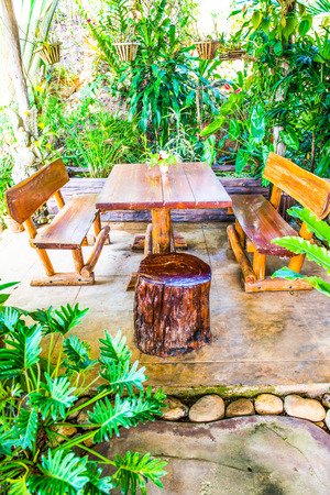small garden: Table set in small garden, Thailand Stock Photo