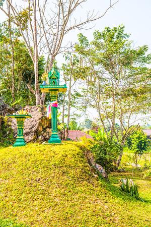 small garden: Spirit house in small garden, Thailand