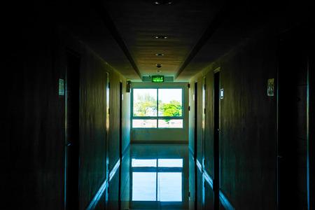 Corridor with light at window, Thailand.