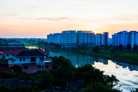 sun rising: Sun rising over Pathum Thani province, Thailand. Stock Photo