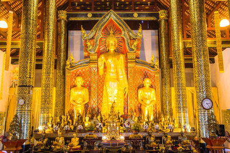 buddhism prayer belief: Standing Buddha  at Wat Chedi Luang Temple, Thailand. Editorial