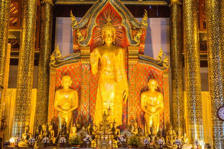 buddhism prayer belief: Standing Buddha  at Wat Chedi Luang Temple, Thailand. Stock Photo