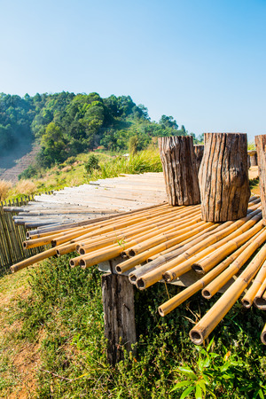 wood bench: Wood bench with bamboo floor on Mon Jam hilltop at Chiangmai province, Thailand.