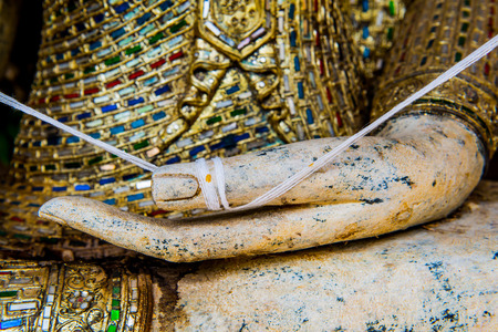 stone buddha: Hand of buddha at Thai temple, Thailand. Stock Photo
