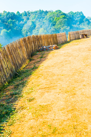 chiangmai province: Bamboo fence with soil walkway on Mon Jam hilltop at Chiangmai province, Thailand. Stock Photo