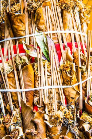 joss: Dry flowers with joss stick for worship, Thailand.