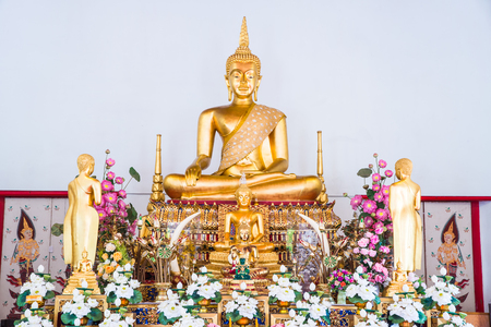 statue: Golden Buddha Statue or Luang Phor Sri Sawan at Nakhonsawan Province, Thailand.