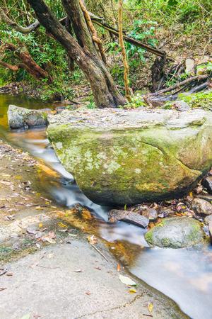 Water Flowing at Wang Bua Ban waterfall in Natural Park, Thailand.