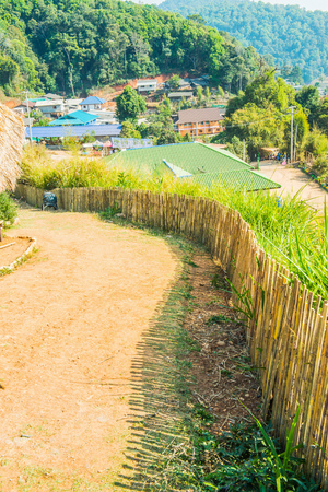 Bamboo fence with soil walkway on Mon Jam hilltop at Chiangmai province, Thailand. Stock Photo