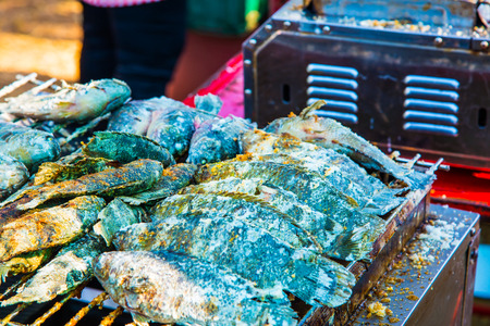 coal fish: Salt grilled fish on sale stand, Thailand