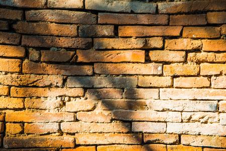 black   shadow: Old brick wall with black shadow, Thailand. Stock Photo