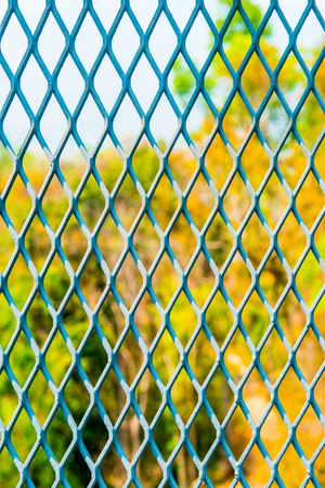 perforated: Perforated Fence of Canopy Walkway, Thailand Stock Photo