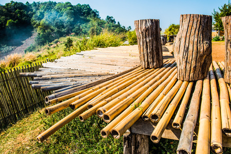 hilltop: Wood bench with bamboo floor on Mon Jam hilltop at Chiangmai province, Thailand.
