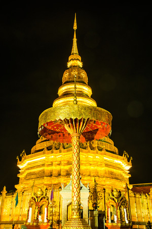 hariphunchai: Phra That Hariphunchai in night time, Thailand Stock Photo