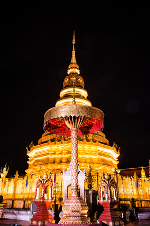 night time: Phra That Hariphunchai in night time, Thailand Stock Photo