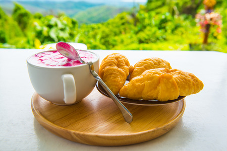 french fancy: Hot fresh milk with fresh croissants on white table, Thailand