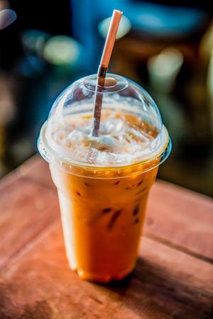 Iced Milk Tea on Wooden Table, Thailand.