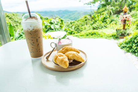 Beverages with fresh croissants on white table, Thailand Stock Photo