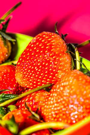 Red strawberries in bowl, Thailand
