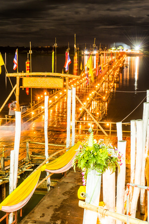 night time: Bamboo bridge on the lake in night time, Thailand