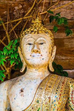 Ancient white buddha in Thai temple, Thailand.