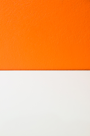 concrete surface finishing: Orange plastering wall with white stripe, Thailand.