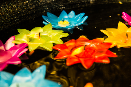 Lotus candle on the water, Thailand Stock Photo