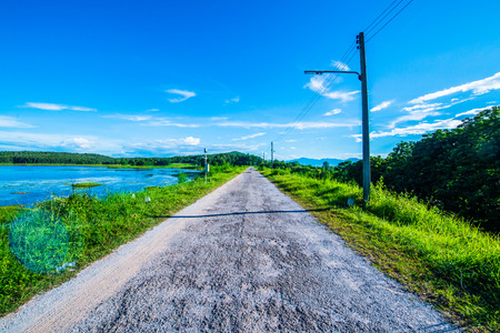 Country Road beside Mae Puem Reservoir , Thailand.