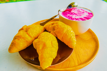 Hot fresh milk with fresh croissants on white table, Thailand