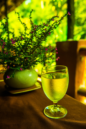 Glass with water on table, Thailand. Stock Photo