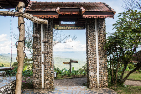 Natural view see through door frame at Huai Nam Dang national park, Thailand.