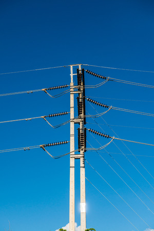 Electrical wire on pole with blue sky, Thailand.